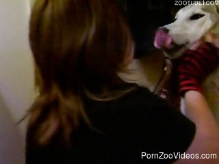 Cute-looking zoophile kisses her playful trained dog